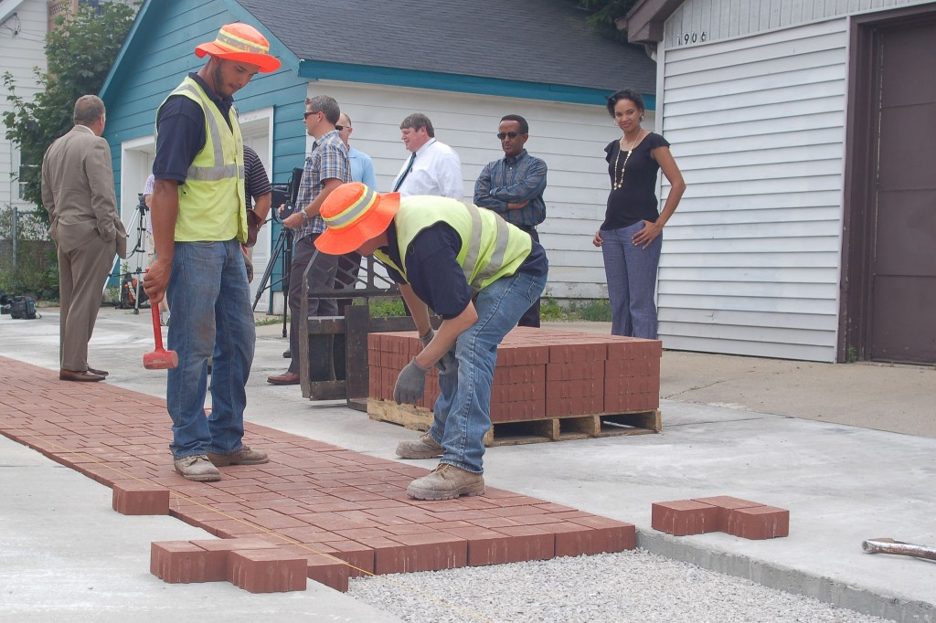 Landscapers strategize how to best place the permeable pavement in the Windlake alley. Photo by Devi Shastri.