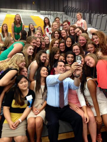 "Governor Walker and delegates from Badger Girls State take a break from their inauguration in Oshkosh to take a ""selfie."" Photo from the State of Wisconsin taken June 19th, 2014."