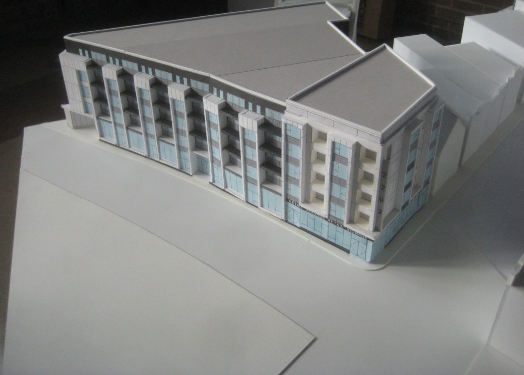 "Model of a planned 5-story, 72-unit ""Gateway to Bay View."" Photo by Michael Horne."