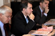 Gov. Scott Walker, then-chairman of the Wisconsin Economic Development Corp., participates in a WEDC board meeting in late 2013 in La Crosse along with CEO Reed Hall, left, and then-chief operating officer Ryan Murray. Walker, a candidate for president, recently removed himself from the board after a negative audit and critical news coverage of the job-creation agency. Photo by Peter Thomson of the La Crosse Tribune.