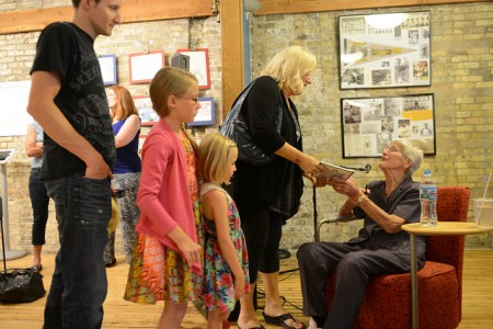 Mike Greer and Celia, Evey and Andrea Skyberg meet with former professional baseball player Joyce Westerman during the grand opening of the exhibit. Photo by Sue Vliet.