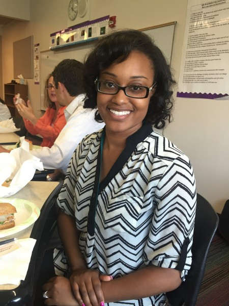 Tianna McCullough, instructional coach for culture at Carver Academy, takes a lunch break after the morning session on adult learning principles. Photo by Andrea Waxman.