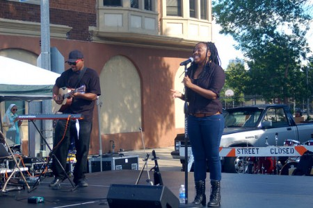 Artaska Aquino takes the stage to celebrate Bronzeville's rich musical history, which made it a regular stop for legendary jazz musicians such as Billie Holliday and Duke Ellington. Photo by Allison Dikanovic.