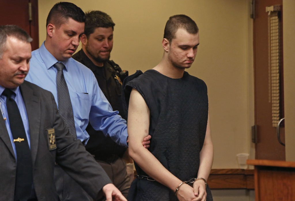 Dean Sutcliffe, 17, of Mazomanie, right, who was charged with the shooting deaths of Ariyl Brady, 16, and Chris Schwichtenberg, 39, is led into his initial appearance at the Dane County Public Safety Building in Madison on Feb. 12. Photo by Amber Arnold of the Wisconsin State Journal.