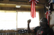 """Former Wisconsin inmate Talib Akbar, seen here in the RV that he now calls home, discusses the psychological toll that spending years in isolation can have on a prisoner. He said he doesn't mind living in his 1981 Dodge Country Squire. """"I'm free to go. So I'm happy."""" Photo by Kate Golden of the Wisconsin Center for Investigative Journalism."""