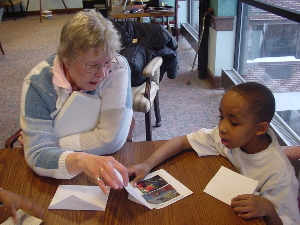 Suzanne Osetek working with a child at Saint John's on the Lake. Photo courtesy of the Nonprofit Center of Milwaukee.