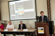 Chris Abele reacts to the new mobile app created by UWM students for the county. Photo by Peter Jakubowski.