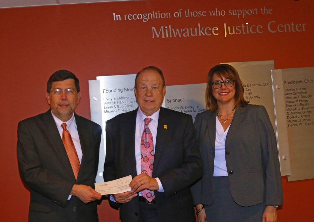 Attorney Hupy with MBA Foundation President Francis W. Deisinger, and Mary Ferwerda, executive director of  the Milwaukee Justice Center.
