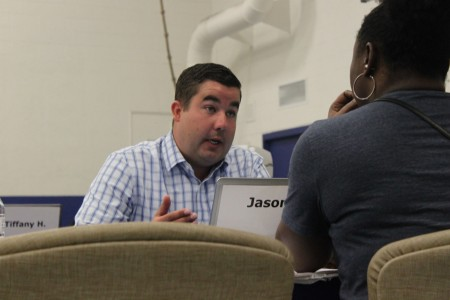 """Jason Knapke, loan advisor with Chase, recently met with homeowners at the """"Save Your Home"""" event at the Martin Luther King Jr. Community Center. Photo by Matthew Wisla."""