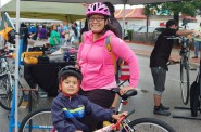 Lauren Lopez and son Mateo, 4, came to Ciclovia MKE because they like to ride their bikes together. Photo by Andrew Waxman.
