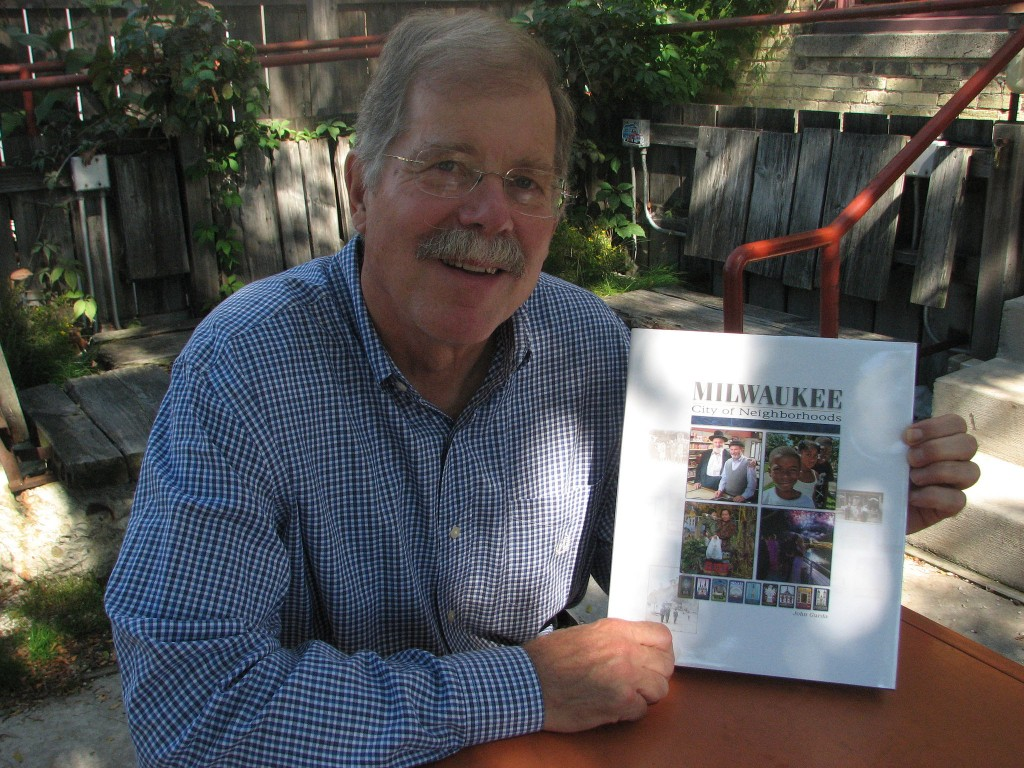 "John Gurda with his new book ""Milwaukee: City of Neighborhoods."" Photo by Brendan O'Brien."