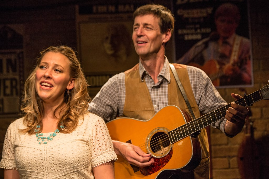 Milwaukee Repertory Theater presents the world premiere production of Back Home Again: On The Road With John Denver in the Stackner Cabaret Sept 11 to Nov 8, 2015. Left to right: Katie Deal and David Lutken. Photo by Tony Duvall.