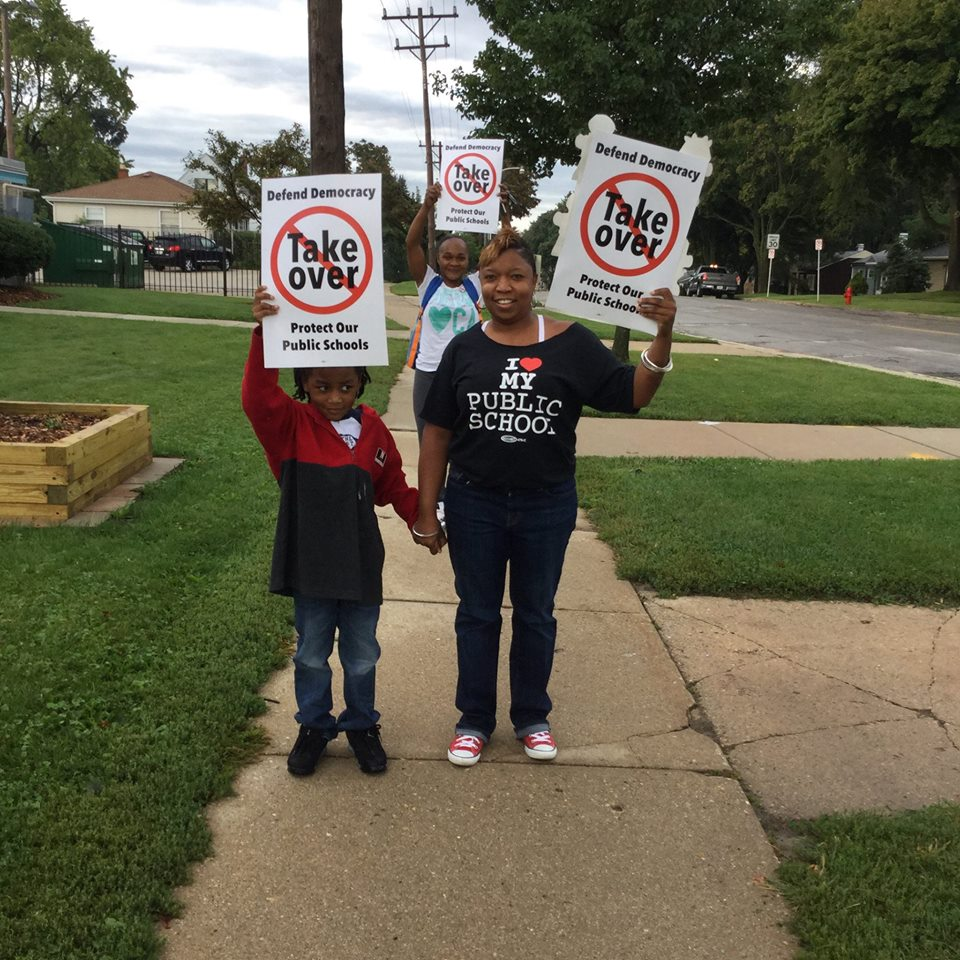 Supporters of Byron Kilbourn Elementary School in Milwaukee participate in the Walk In for Public Education on Friday, a districtwide response to a law allowing politicians to take over neighborhood public schools and hand them over to unaccountable voucher or privately run charter schools without input from parents or citizens. Photo courtesy of the MTEA.
