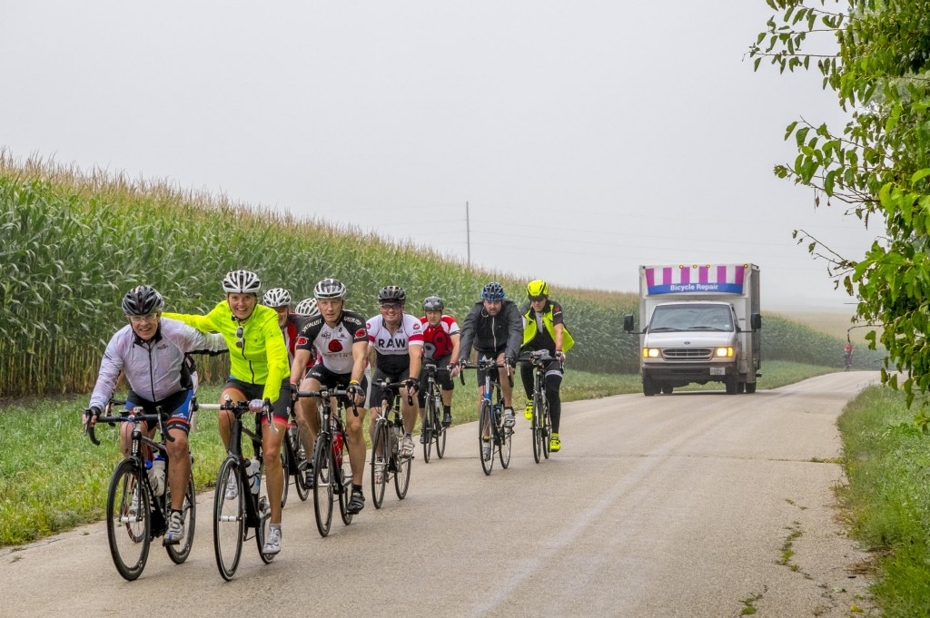 Tanya Burke, wife of John, CEO of Trek, rides with some friends with Julian Kegel in one of the Wheel & Sprocket support vehicles not far behind. Julian and his crew fixed lots of flats because of the wet roads in the early morning hours.