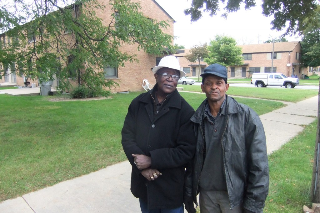 Lynell Quin (right) and Clarence Lee said the Westlawn neighborhood needs better parks and a pharmacy. Photo by Wyatt Massey.