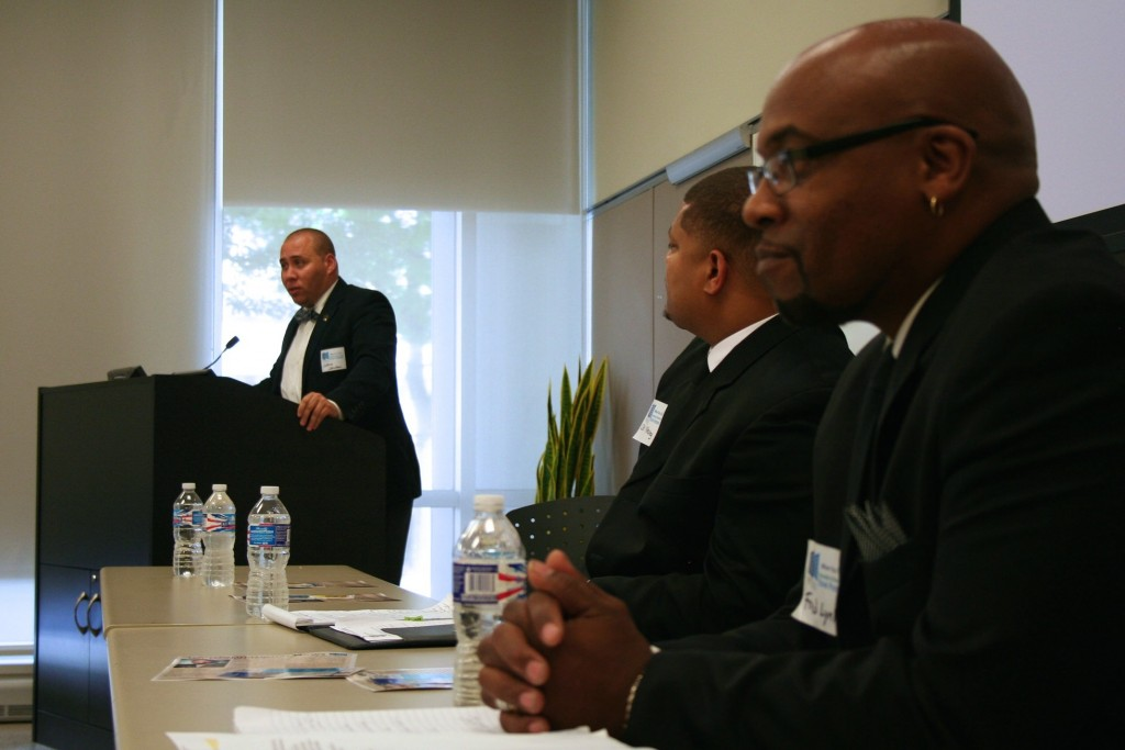 Joshua Johnson (left) addresses attendees at a conference intended to encourage employers to hire ex-convicts. Photo by Jabril Faraj.