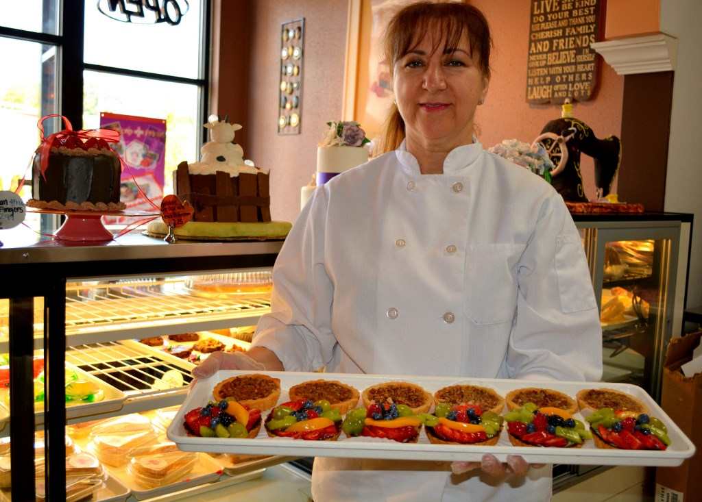 Gloria De Angelo shows off her popular fruit tarts and pecan pastries. Photo by Marlita Annette Bevenue.
