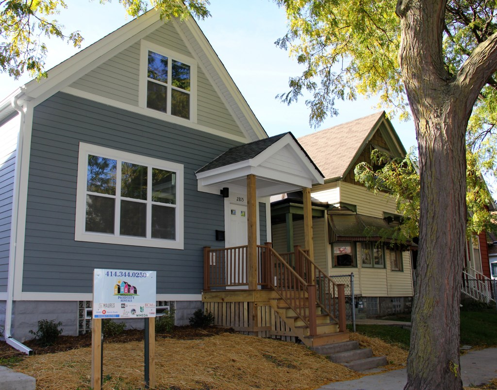 This old home's new look is giving hope to neighbors in the Harambee neighborhood, an area hit hard by the tax-foreclosure crisis. Photo by Karen Slattery.