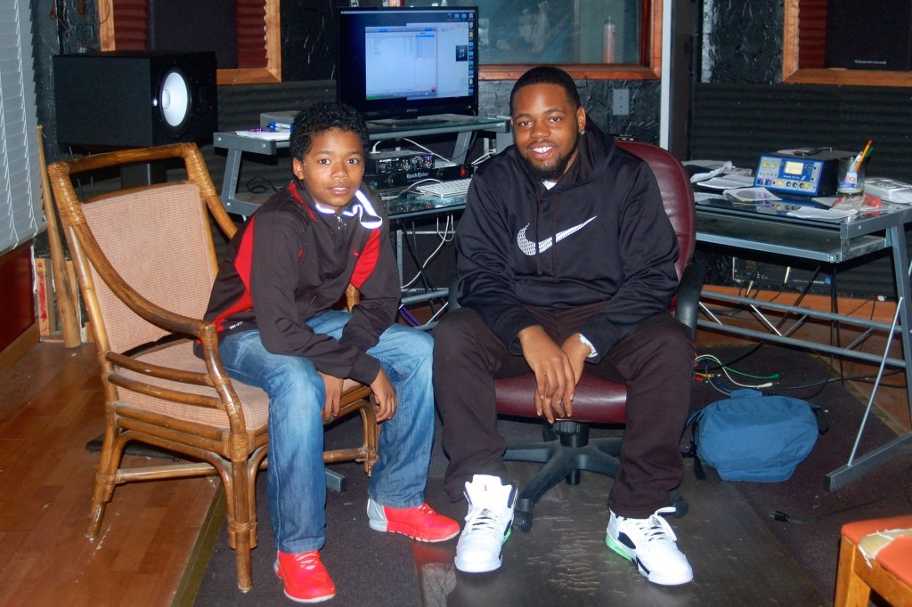 Victor Barnett Jr. and his mentor Dae Hill produce their rap music in the studio at Running Rebels. Photo by Allison Dikanovic.