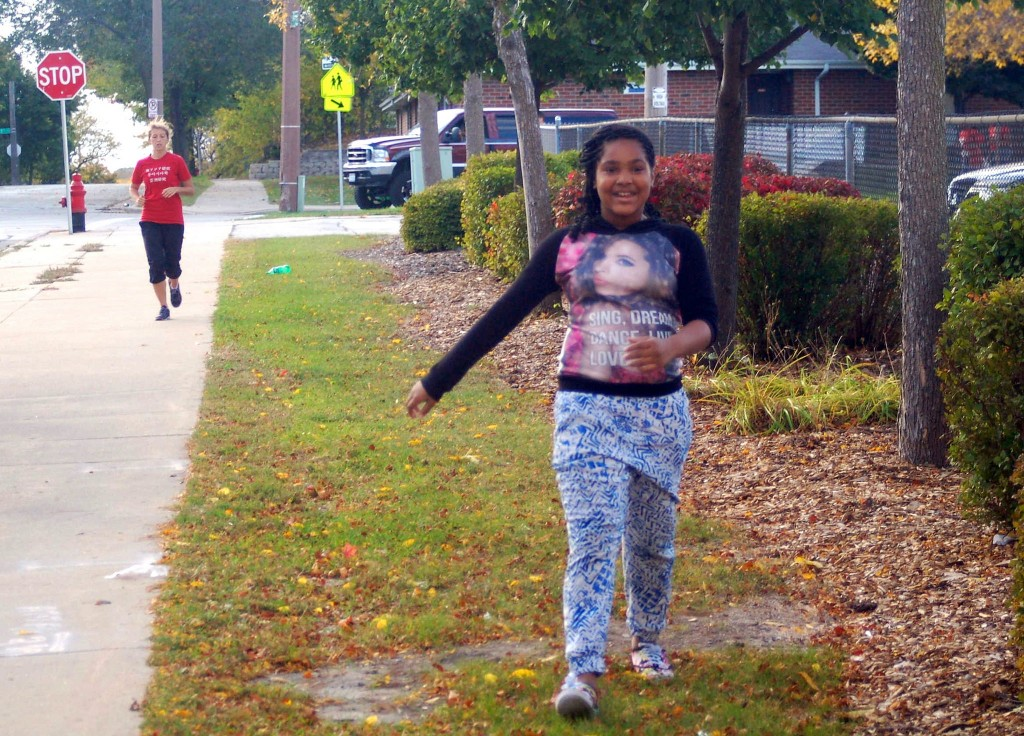 A participant in Kids Run Milwaukee rejoices as she finishes her last lap of the day. Photo by Allison Dikanovic.