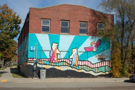 The mural wraps around the vacant building on the northeast corner of Lisbon Avenue and 31st Street. Here it is viewed from Lisbon Avenue. Photo by Andrea Waxman.
