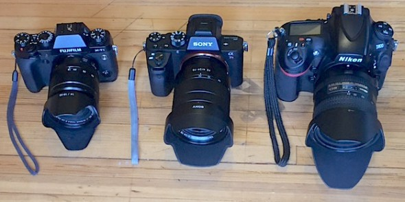 Fuji X-T1 with XF18-55 f/2.8-4, Sony A7rII with FE 24-70 f4, Nikon D800 with Nikkor 24-85 f/2.8-4D IF. You can see the Fuji, a crop sensor camera, is the smallest of the bunch, but the Sony is pretty close. I use the medium zoon lenses for almost everything I shoot while on the bike.