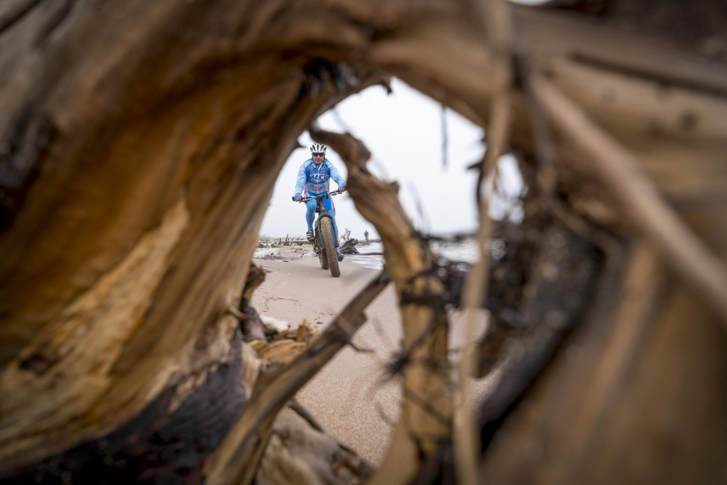The Sony A7rII autofocus had no trouble picking up John Fleckenstein through the knot in this driftwood and tracking him as he rode toward me, pretty awesome.