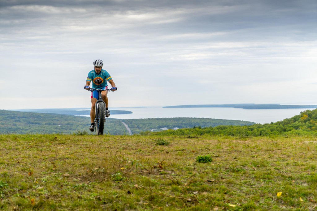 Fleck on top of Mt Ashwabay with Bayfield, Madeline Island and Lake Superior in the background. Forget the idea that fat bikes are slow, the feather-weight carbon Fyxation Blackhawk climbs like a dream. Photo with Sony A7rII.