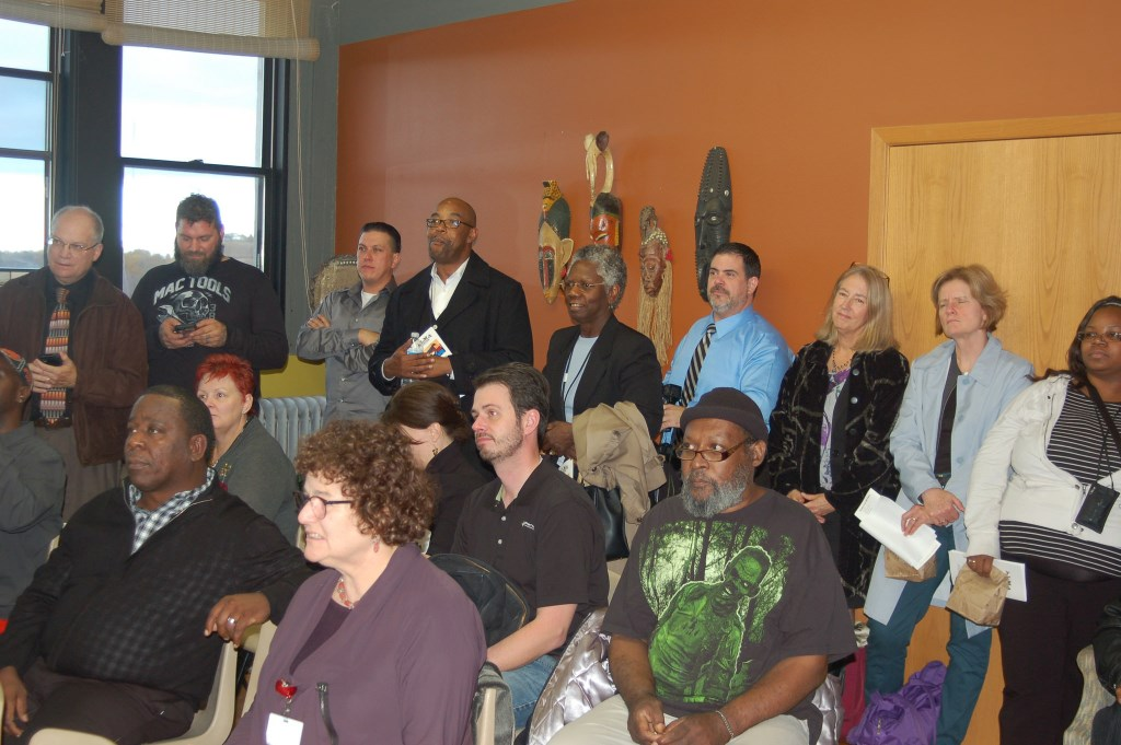 Open house attendess listen to Milwaukee Circuit Court Chief Judge Maxine White speaking about the improtance of the Alma Center's work. Photo by Andrea Waxman.