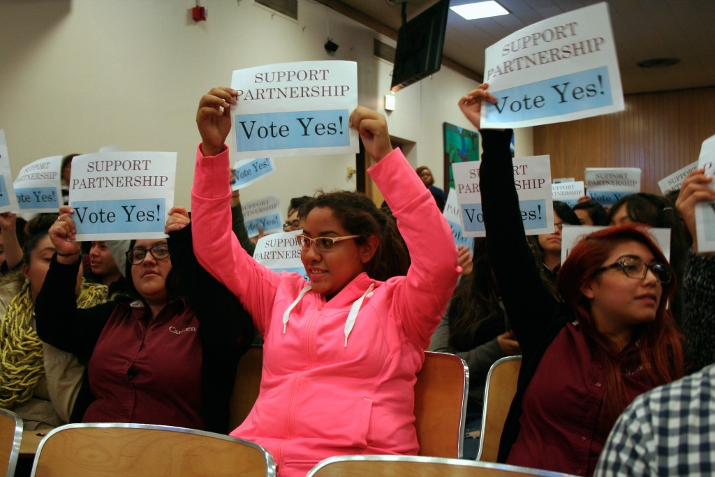Carmen South students display signs during the October board meeting. Photo by Jabril Faraj.