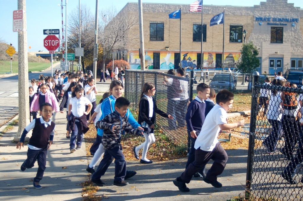 Bruce Guadalupe Community School students rush to the playground in Walker Square Park during recess. Photo by Edgar Mendez.