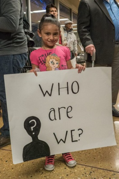 A small girl holds a sign during a rally for supporters of the municipal ID held recently at the Mitchell Park Domes. Photo by Joe Brusky; courtesy of Milwaukee Teachers' Education Association.