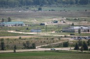An aerial view looking east shows the grounds of the Badger Army Ammunition Plant near Baraboo in 2012. The Army continues to clean up groundwater pollution left by the now-defunct manufacturing plant and has proposed building a drinking water system for about 400 nearby homes whose wells are tainted or at risk of contamination. Photo by John Hart of the Wisconsin State Journal.