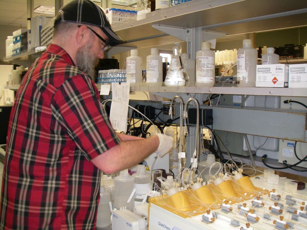 Ian Torkelson runs a test for the presence of nitrate and phosphorous in water at the University of Wisconsin-Stevens Point's Center for Watershed Science and Education. Photo by Debra Sisk of the University of Wisconsin-Stevens Point.