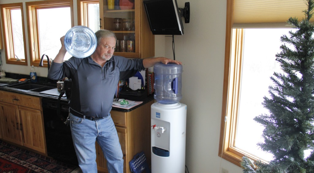 Frank Michna buys bottled water for drinking and cooking in his Caledonia home because of high levels of molybdenum and boron in his well. Photo by Cole Monka of the Wisconsin Center for Investigative Journalism.