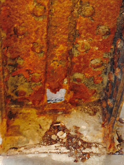 Holes in Old Rusty. Photo by Cheryl Nenn.