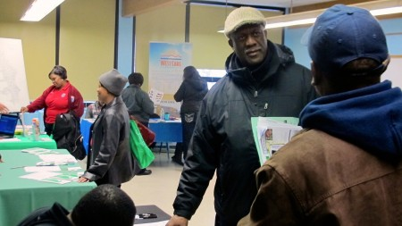 Charles Muhammad attended the housing fair to learn about city programs that can help him improve the empty lot adjacent to his home. Photo by Wyatt Massey.