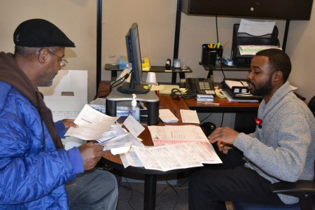 A volunteer tax preparer works with a client at SDC's Teutonia site. Photo courtesy of SDC.