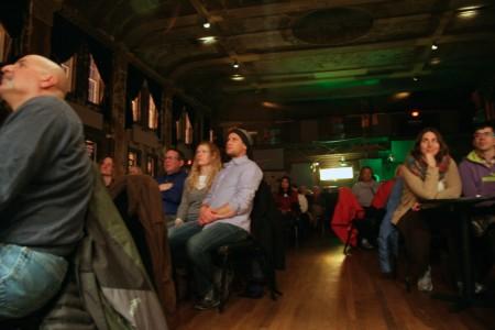 Audience members look on as performers tell their stories. Photo by Jabril Faraj.