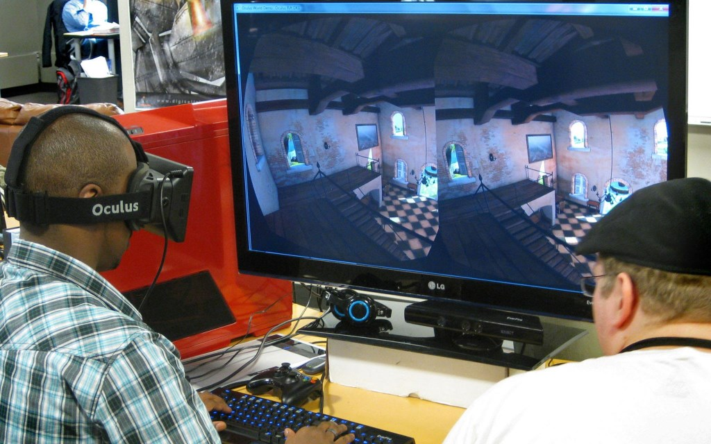 The team at Digital Iris trying out an Oculus Rift VR Development kit. Photo from Facebook.