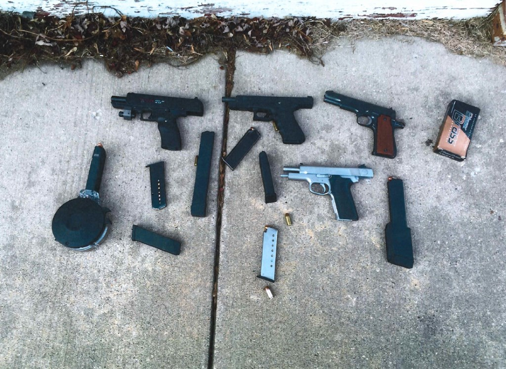 Several guns and tons of ammunition recovered by the Milwaukee Police Department. Photo courtesy of the Milwaukee Police Department.
