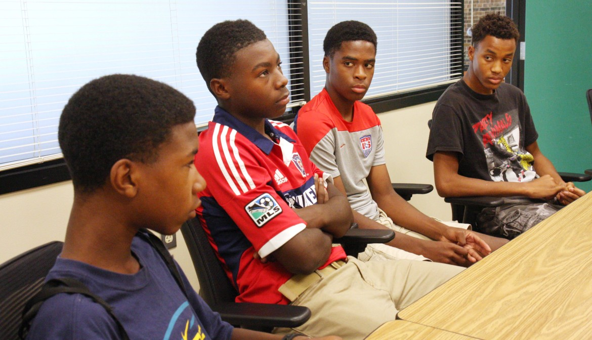 From left, Memorial High School students William Lemkuil, Demitrius Kigeya, Odoi Lassey and Robert Bennett say they face racial stereotypes at school. Photo by Joseph W. Jackson III of the Wisconsin Center for Investigative Journalism.