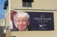 """We Can Make Your Hair Great Again!"" This eye catching billboard is located along N. Van Buren St. Photo by Carl Baehr."