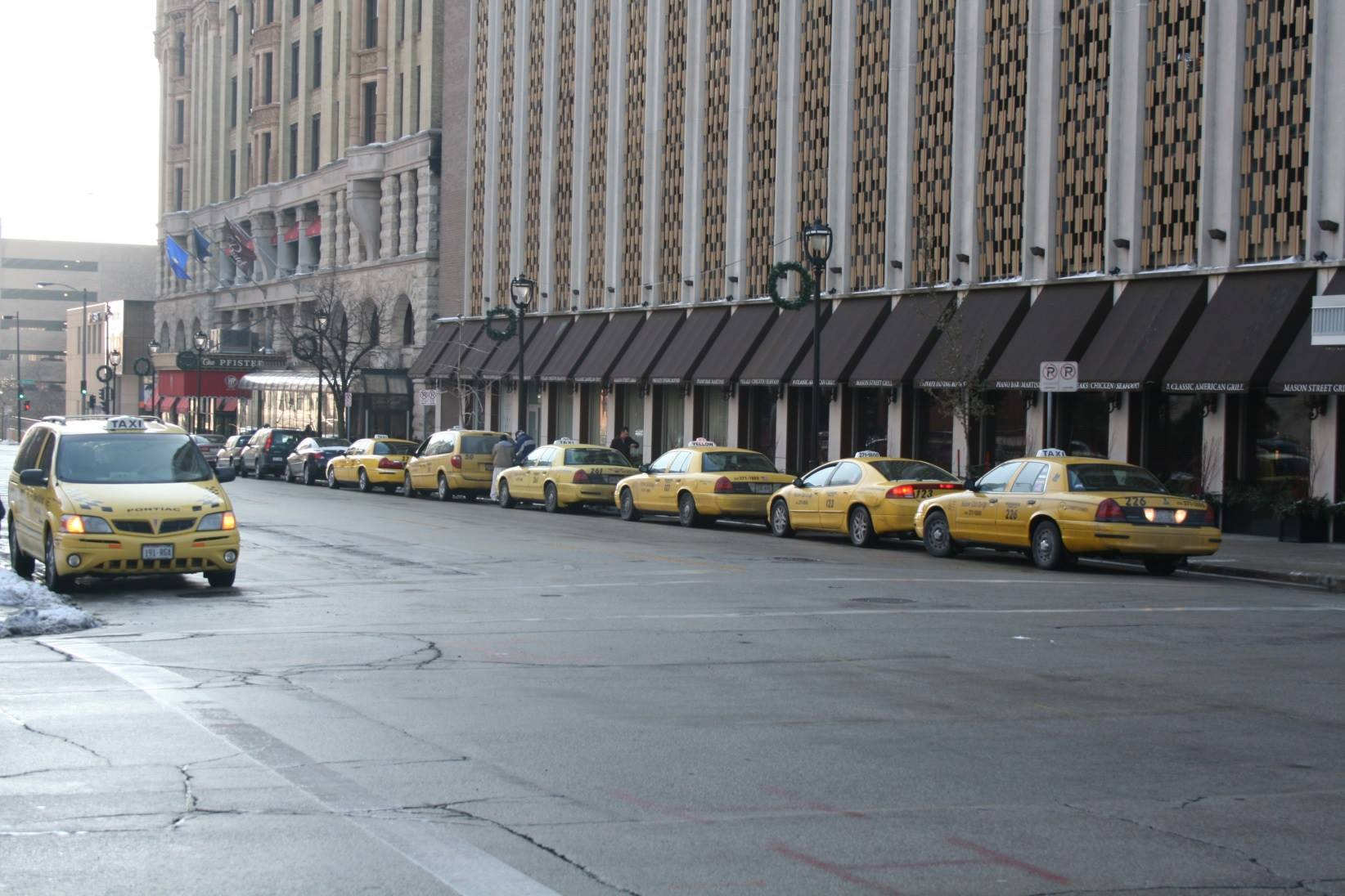 Cabs in front The Pfister. Photo by Jeramey Jannene.