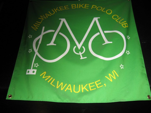 Green and gold flag of the Milwaukee Bicycle Polo Club. Photo by Michael Horne.