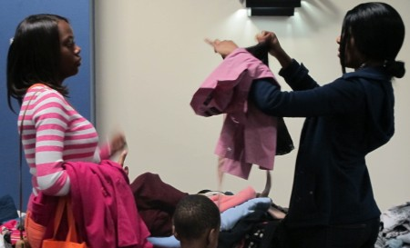 Homeless mothers search through the clothing bank at United Way's Homeless Connect, an all-day resource fair held annually at Marquette University. Photo by Andrea Waxman.