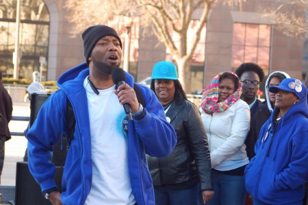 Dameion Perkins, one of Dontre Hamilton's brothers, sings a song of hope at a demonstration on April 30, 2015, to mark the first anniversary of Dontre Hamilton's death. Photo by Andrea Waxman.