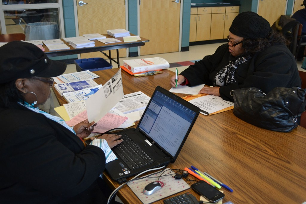 A volunteer tax preparer works with a client at SDC's Teutonia site. Photo provided by SDC.
