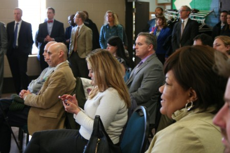 A crowd of corporate partners and local government employees looks on during the announcement. Photo by Jabril Faraj.