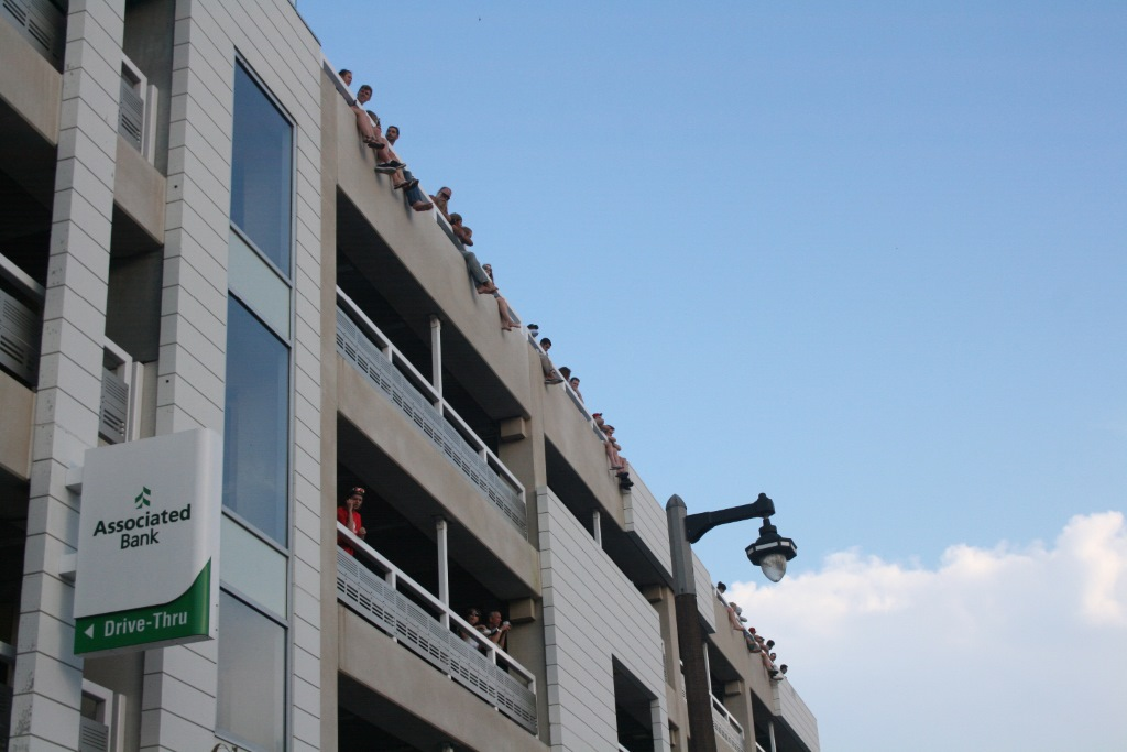 Race fans sit atop the Downer Avenue Parking Garage. Photo by Jeramey Jannene.